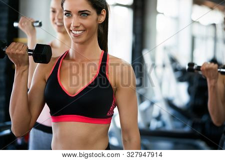 Fitness, Sport, Training, Gym And Lifestyle Concept. Group Of Women Working Out In Gym