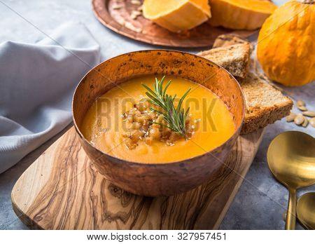Homemade Autumn Butternut Squash Pumpkin Cream Soup With Bread And Seeds. Top View. Pumpkin Cream So
