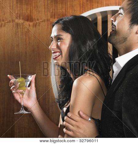 Multi-ethnic couple with martini