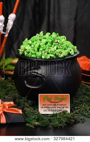 Cauldron Green Sweet Popcorn For Ghouls And Zombies. Halloween Treat
