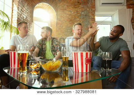 Group of excited friends playing video games at home. Male gamers or fans spending time and having fun together at home. Emotional, expressive, exciting gameplay. Modern tech, friendship, weekend. poster