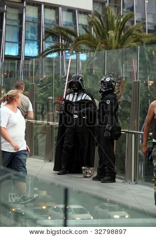 LAS VEGAS, USA - April 25: Darth Vader and Storm Trooper impressionists in Las Vegas. 4th May is International Star Wars day. Word play on film quote: May the Fourth [force] be with you. 25 April 2012