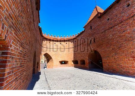 Warsaw, Poland Barbican Or Barbakan Semicircular Fortified Xvi Century Outpost With The Defense Wall