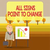 Conceptual hand writing showing All Signs Point To Change. Business photo showcasing Necessity of doing things differently new vision Businessman with Brief Case Standing Whiteboard Bar Chart. poster
