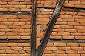 Old frame-build half-timbered red bricks barn's wall horizontal poster