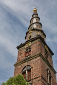 Detail of the Church of Our Saviour (Vor Frelsers Kirke), Copenhagen, Denmark. It is famous for its helix spire with an external winding staircase that can be climbed to the top. poster