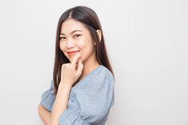 Smiling Young Asian Beautiful Women Posting On White Background
