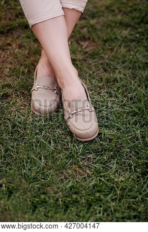 Close Up Of Stylish Female Shoes On Grass. Outdoor Fashion Shoes Footwear Concept.