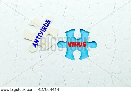 Jigsaw Puzzle With The Words Virus And Antivirus. The Concept Of Safety