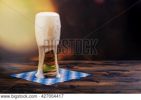 Golden Beer In A Glass Stein For Oktoberfest Party On Bar Counter