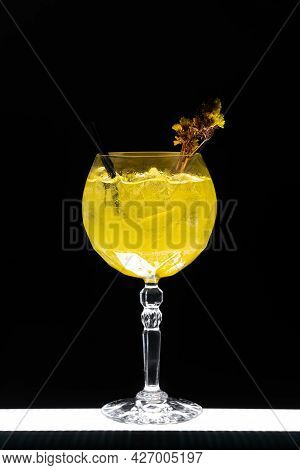 Luxury Gin Hass Orange Cocktail Drink With Ice In Glass On Black Background