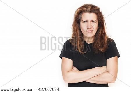 Beautiful Woman With Irritated Hair And An Angry Face. It Can Be Seen That A Woman Is Good, But For