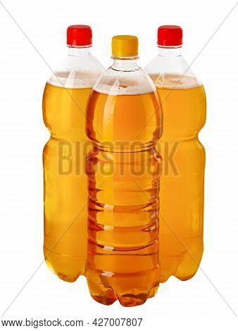 Beer On Tap. These Are Three Plastic Bottles Of Natural Draught Beer In Isolation On A White Backgro