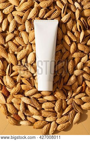 Almond Cream Tube Cosmetic Background With Almonds Nuts In Shell, Top View, Copy Space, Mockup, Vert