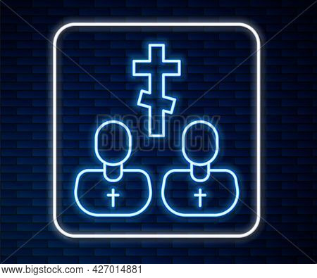 Glowing Neon Line Priest Icon Isolated On Brick Wall Background. Vector