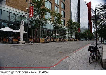 Montreal, Qc, Canada - 7-15-2021: Sainte Catherine Street - People Enjoy Their Time At A Restaurant