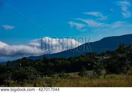 Landscape Of A Mountain Valley With Clouds In The Crimean Mountains Above Gurzuf.