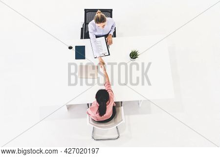 Two Young Business Women In Meeting At Office Table For Job Application And Business Agreement. Recr