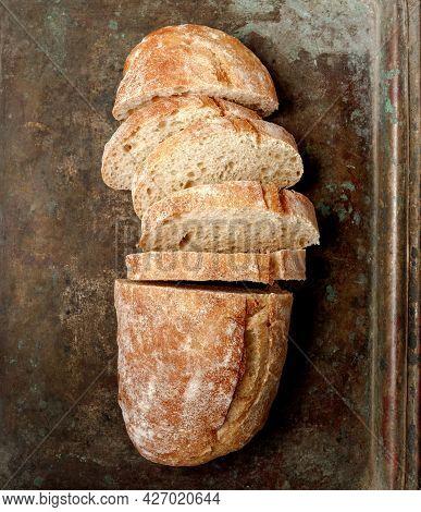 Sliced Bread Ciabatta On Vintage Metallic Tray. Top View Of Homemade Ciabatta. Flat Lay.