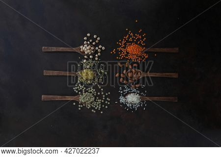 Different Type Of Raw Dry Legumes Composition. White Beans, Lentils, Bulgur, Chickpeas, Kidney Beans