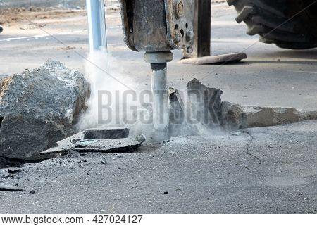 Road Repair Concept. Removal Of The Old Layer Of Asphalt With A Hydraulic Hammer. Pavement Reconstru