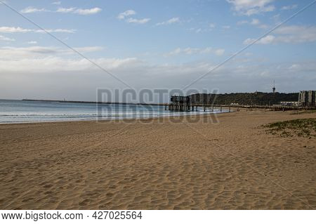 Durban Beach With Pier And Bluff In Background