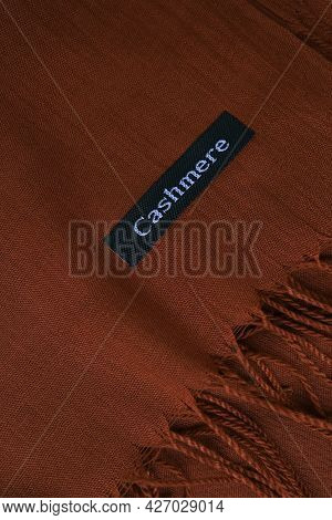 Deep Brown Cashmere Texture. Chocolate Textile Background. Fabric Label On Coffee Cashmere Scarf. Ma
