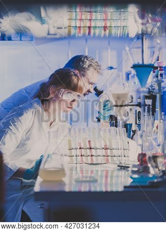 Health Care Professionals Researching In Scientific Laboratory.
