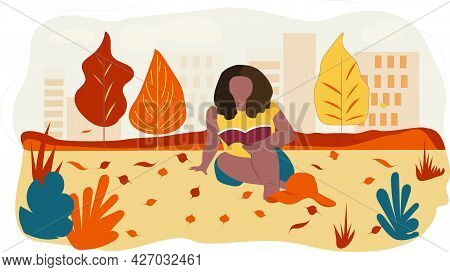 Beautiful Woman With Afro Hairstyle Reading A Book In The Autumn Park.