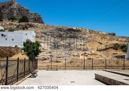 Lindos, Greece - Jun 05, 2021. A Theatre Carved Out Of Rock Has Been Uncovered On The Southern Slope