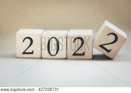 The Year 2022 Written On Wooden Cubes, Finger Flipping Year To Year, New Year Concept Background, St