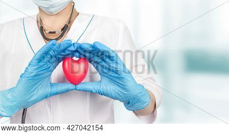 Doctor Holding A Red Heart At Hospital Office. Medicine And Healthcare Concept, Health Care Love, Gi