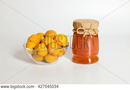 Quince Jam On A White Background. Jar Of Jam And Quince Fruit In A Bowl.