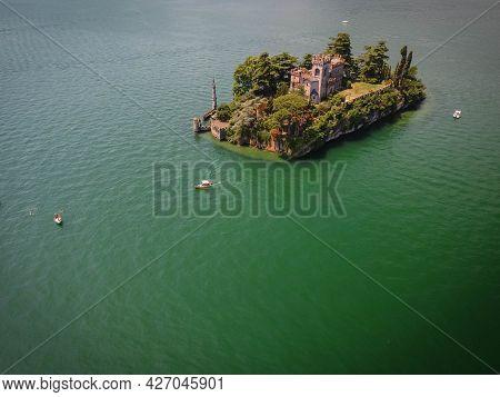 Boats Around The Island Of Loreto On Lake Iseo, Lombardy, Italy
