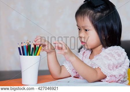 Schoolgirl Are Picking Up Paint For Homework. Cute Kid Age 4-5 Years Old.