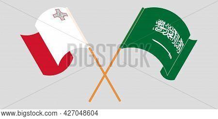 Crossed And Waving Flags Of Malta And The Kingdom Of Saudi Arabia