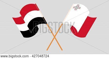Crossed And Waving Flags Of Malta And Yemen