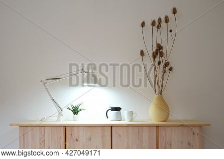 Wooden Sideboard With Lamp And Decoration In Front Of White Room Wall, Interior And Home Concept Wit