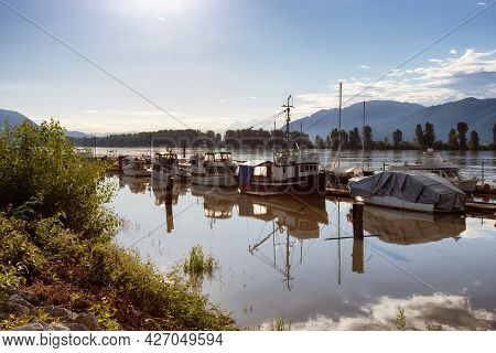 Mission, Fraser Valley, British Columbia, Canada - June 8, 2021: Boats Parked At A Dock In The River