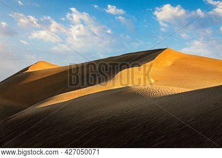 Sam Sand dunes of Thar Desert under beautiful sky on sunset. Rajasthan, India