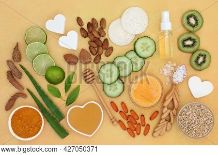 Natural ingredients for healthy skin to treat skin ailments including sunburn, acne, psoriasis, eczema and  helps to reduce environmental damage. Top view on mottled yellow background.