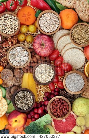 Healthy food collection high in dietary fibre for gut health with foods also high in antioxidants, minerals, vitamins, anthocyanins, omega 3, protein and lycopene.  Healthcare concept. Flat lay.
