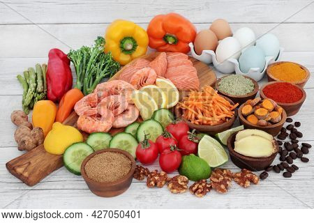 Flexitarian diet food for healthy planet concept high in protein, omega 3, vitamins, minerals, antioxidants, anthocyanins an fibre. Immune boosting low cholesterol healthcare concept on rustic wood.