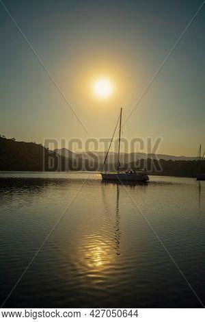 Boat during sunset in Mediterranean Sea Turkey