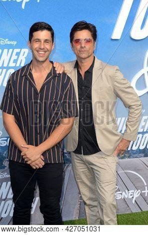 LOS ANGELES - JUL 15:  Josh Peck, John Stamos at Disney+