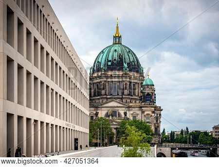Berlin, Germany - Juny 13, 2021: Cityscape from Spree River a cloudy day of summer with Berliner Dom Cathedral and Humboldt Forum