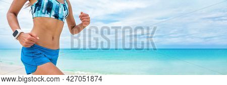 Fitness sport smart watch wearable technology smartwatch runner girl training cardio outside on beach. Running woman workout.