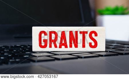 Grants Word On Paper Folder Showing Scholarship Or Higher Education Concept.