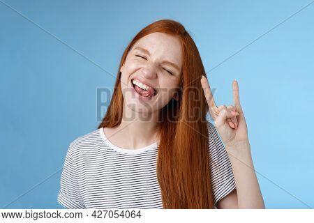 Happy Cheerful Carefree Chilling Redhead Teenage Girl Having Fun Stick Tongue Close Eyes Dancing Joy