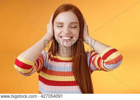 Dreamy Charismatic Relaxed Tender Redhead Caucasian Girl 20s Close Eyes Cover Ears Imaging Far Away,